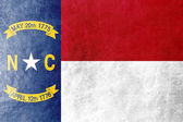 North Carolina State Flag painted on leather texture — Stock Photo