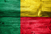Benin Flag painted on old wood plank texture — ストック写真