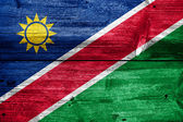 Namibia Flag painted on old wood plank texture — Stockfoto
