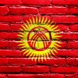 Stock Photo: KyrgyzstFlag painted on brick wall