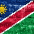 Stock Photo: NamibiFlag painted on grunge wall