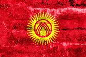Kyrgyzstan Flag painted on grunge wall — Foto Stock