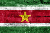 Suriname Flag painted on grunge wall — Foto Stock