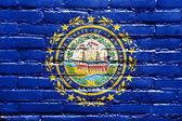 New Hampshire State Flag painted on brick wall — Stock Photo