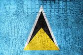 Saint Lucia Flag painted on luxury crocodile texture — Stock Photo