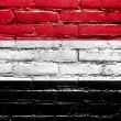 Stock Photo: Yemen Flag painted on brick wall
