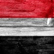 Stock Photo: Yemen Flag painted on old wood plank texture