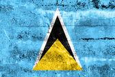 Saint lucias flagga målade på grunge vägg — Stockfoto