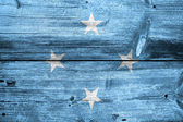 Micronesia Flag painted on old wood plank texture — Stockfoto