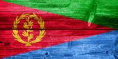 Eritrea Flag painted on old wood plank texture — Stock Photo