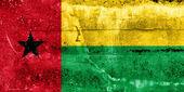 Guinea Bissau Flag painted on grunge wall — Stok fotoğraf