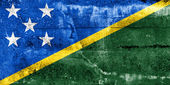 Solomon Islands Flag painted on grunge wall — Stock Photo