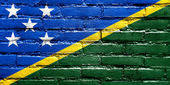 Solomon Islands Flag painted on brick wall — Stockfoto