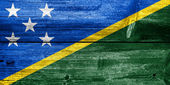Solomon Islands Flag painted on old wood plank texture — Stock Photo