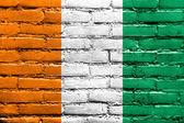 Ivory Coast Flag painted on brick wall — Foto Stock