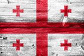Georgia Flag painted on old wood plank texture — Stockfoto