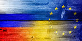 Ukraine, EU and Russia Flag painted on old wood plank texture — Stock Photo