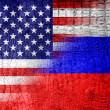Stock Photo: USand RussiFlag painted on luxury crocodile texture