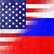 Stock Photo: USand RussiFlag painted on leather texture