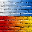 Stock Photo: Poland and Ukraine Flag painted on brick wall