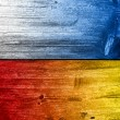 Stock Photo: Poland and Ukraine Flag painted on old wood plank texture