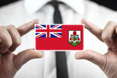 Businessman holding a business card with Bermuda Flag — Stock Photo