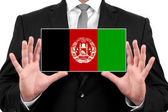 Businessman holding a business card with Afghanistan Flag — Stock Photo