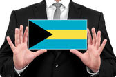 Businessman holding a business card with Bahamas Flag — Foto de Stock