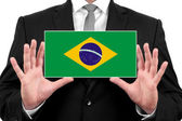 Businessman holding a business card with Brazil Flag — Foto de Stock