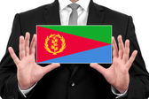 Businessman holding a business card with Eritrea Flag — Stock Photo