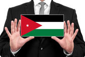 Businessman holding a business card with Jordan Flag — Stock fotografie