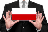 Businessman holding a business card with Poland Flag — Stock Photo