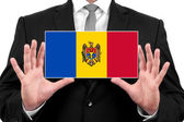Businessman holding a business card with Moldova Flag — Stock Photo