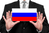 Businessman holding a business card with Russia Flag — Stok fotoğraf