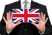 Businessman holding a business card with UK Flag — Stock Photo