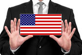 Businessman holding a business card with USA Flag — Stock Photo