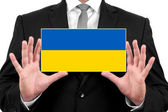 Businessman holding a business card with Ukraine Flag — Foto de Stock