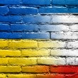Stock Photo: Autonomous Republic of Crimeand Ukraine Flag painted on brick wall