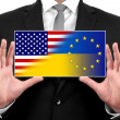 Businessman holding a business card with Ukraine, EU and USA Flag — Stock Photo #42250785