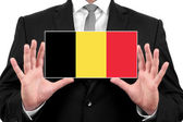 Businessman holding a business card with Belgium Flag — Foto de Stock