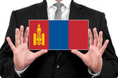 Businessman holding a business card with Mongolia Flag — Foto de Stock