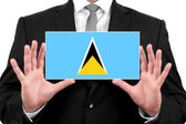 Businessman holding a business card with Saint Lucia Flag — Stock Photo