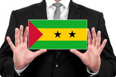Businessman holding a business card with Sao Tome and Principe Flag — Foto de Stock