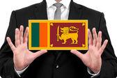 Biznesmen posiadania wizytówki z flaga sri lanka — Zdjęcie stockowe