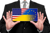 Businessman holding a business card with Ukraine, EU and USA Flag — Stockfoto