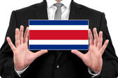 Businessman holding a business card with Costa Rica Flag — Stock Photo