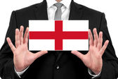 Businessman holding a business card with England Flag — Stock Photo