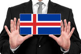 Businessman holding a business card with Iceland Flag — Stock Photo