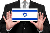 Biznesmen posiadania wizytówki z flagą izraela — Zdjęcie stockowe