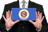 Businessman holding a business card with Minnesota State Flag — Foto de Stock